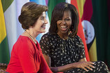 First Lady Michelle Obama laughed alongside former First Lady Laura Bush at the African First Ladies Summit in Dar es Salaam, Tanzania, in July.