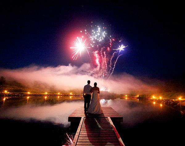 The sky burst with color at this wedding in Ontario, Canada. Photo by A Simple Photograph via Style Me Pretty