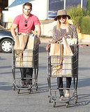 Henry Cavill and Kaley Cuoco headed to their car with groceries.