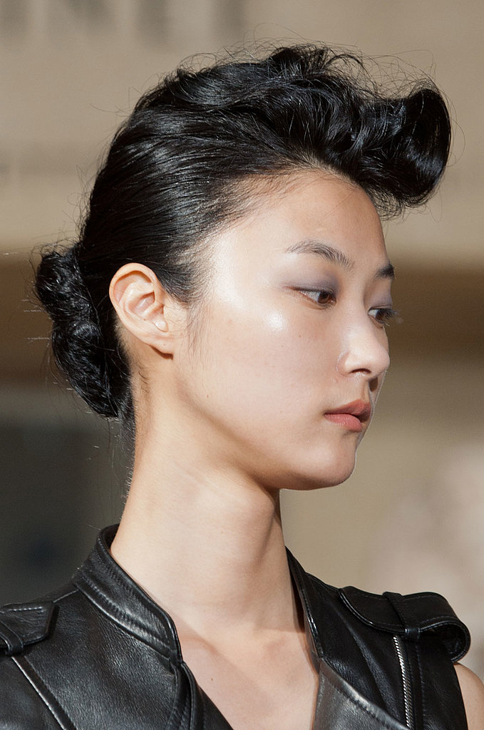 It was a combination of pompadour and chignon on the Bouchra Jarrar runway, and the eye makeup was perfect for Fall: gray shadow paired with a peachy pout.