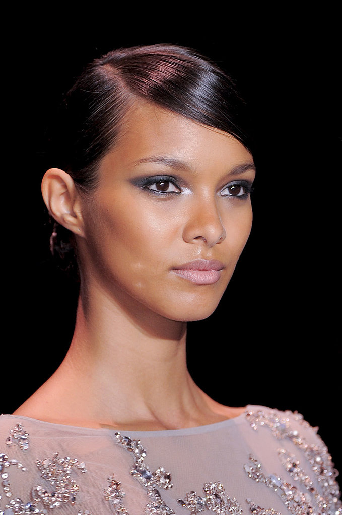 At Elie Saab, the makeup centered around an angular eye with black and metallic tones. A subtle rosy lip completed the look.