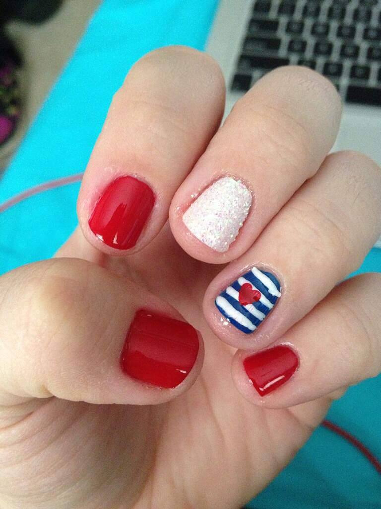 A dainty heart and sparkles make this patriotic manicure something to celebrate.  Source: Twitter user meganzella