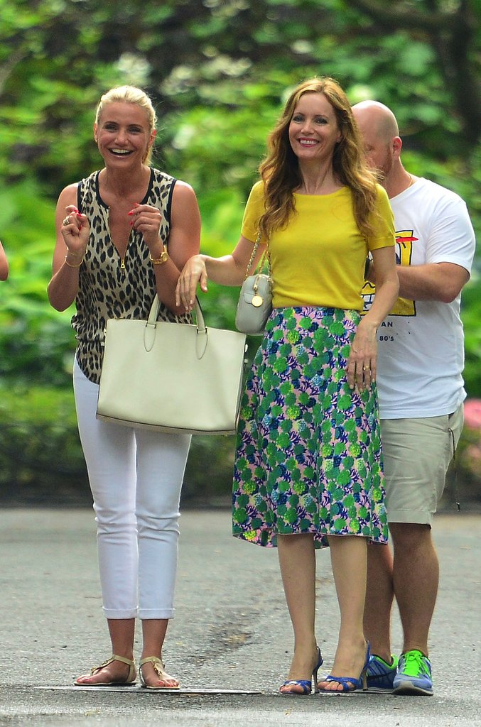 Leslie Mann's character was a vision of happy in her ladylike ensemble. Get the look by tucking a bold tee into a printed skirt, then add equally loud sandals.