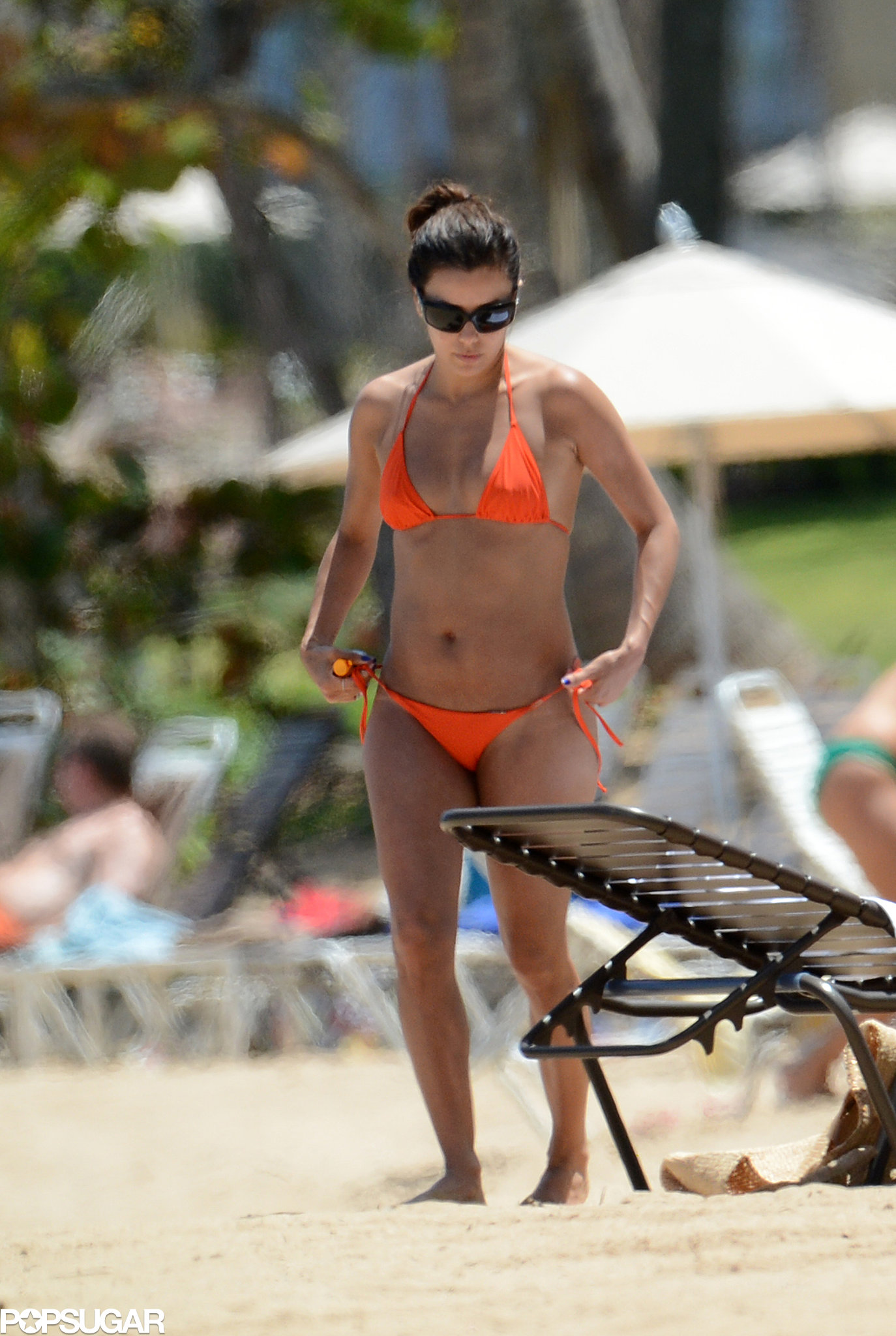Eva Longoria worked her bright orange bikini in Puerto Rico in April 2013.