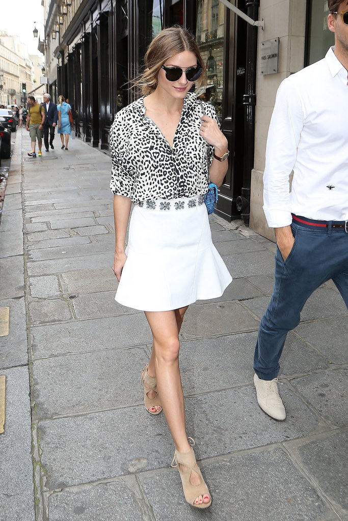 Red carpet or sidewalk, it hardly matters for street-style favorite Olivia Palermo. She made a simple Parisian stroll look good in a flared white mini, tucked-in leopard button-down, and nude sandals.