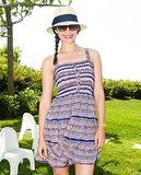Attending a Hamptons Fourth of July celebration, Emmy Rossum wore a straw hat and side braid, but it's her bright red lip color that we're looking to steal. How patriotic!
