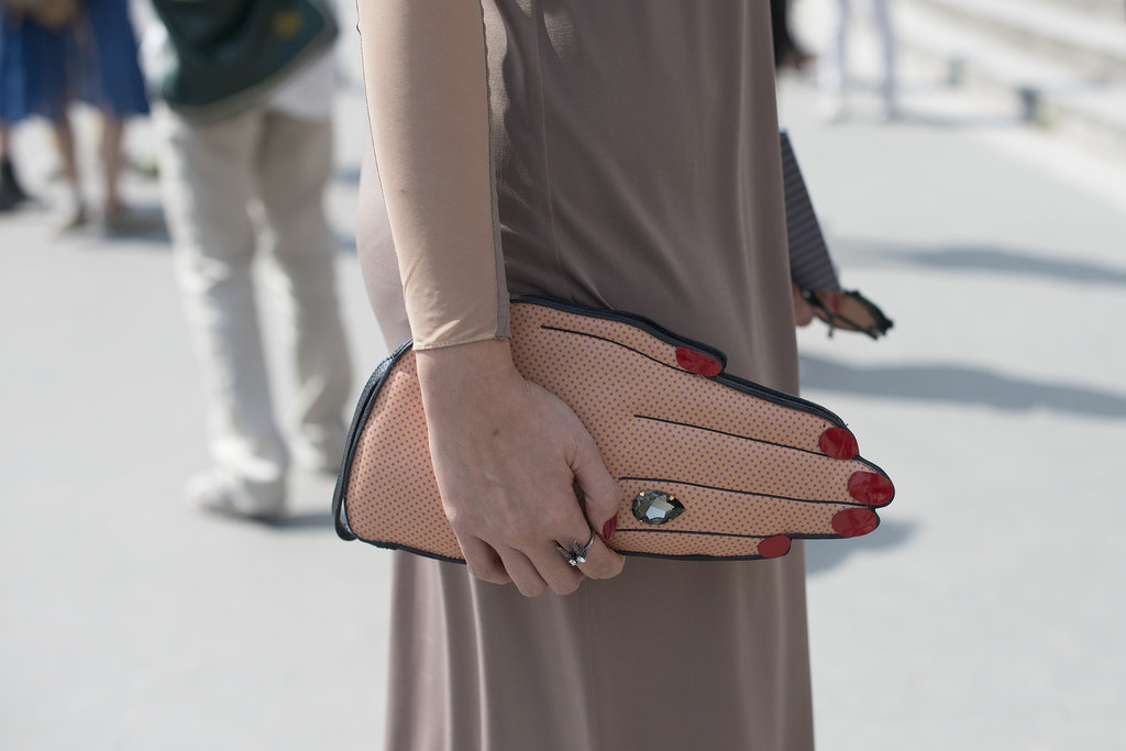 Harper's Bazaar Thailand Editor in Chief Duang Poshyanonda takes the handsy approach to her street-style accessorizing.