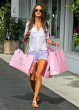 For a major shopping spree at Calypso, Alessandra Ambrosio tucked a white Bella Dahl blouse into Black Orchid striped denim cutoffs, then finished with white t-strap sandals.