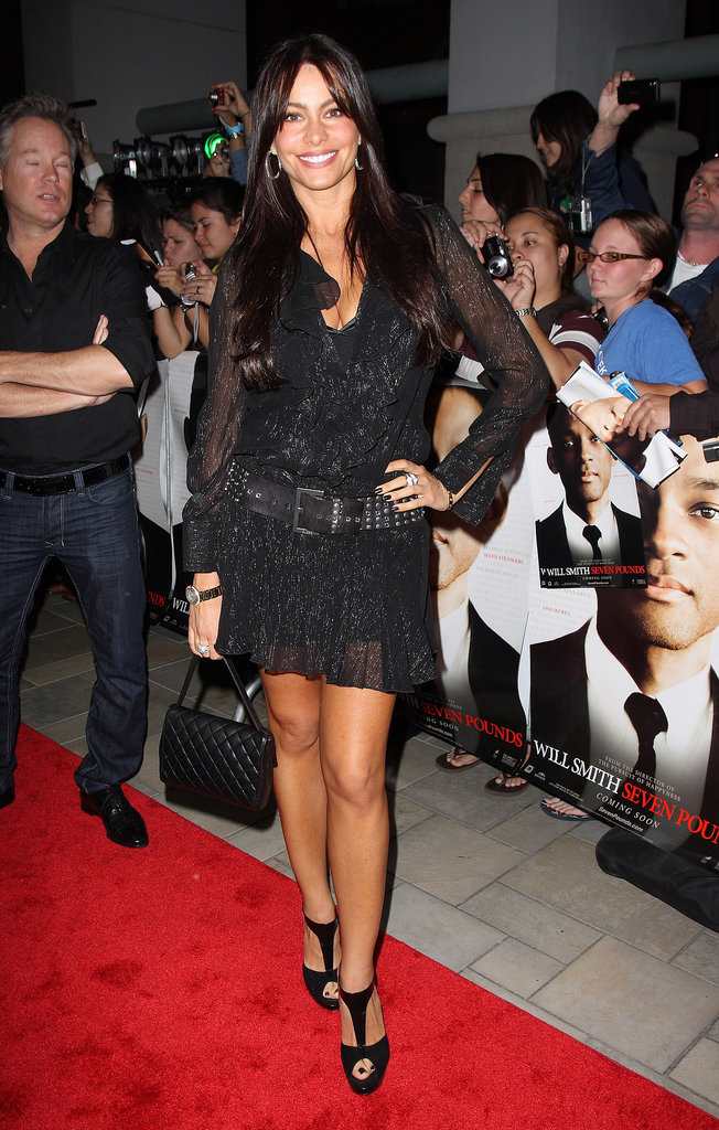 For the Seven Pounds Miami premiere, Sofia Vergara went black-on-black in a shimmering ruffled mini, t-strap sandals, and a low-slung grommet belt.