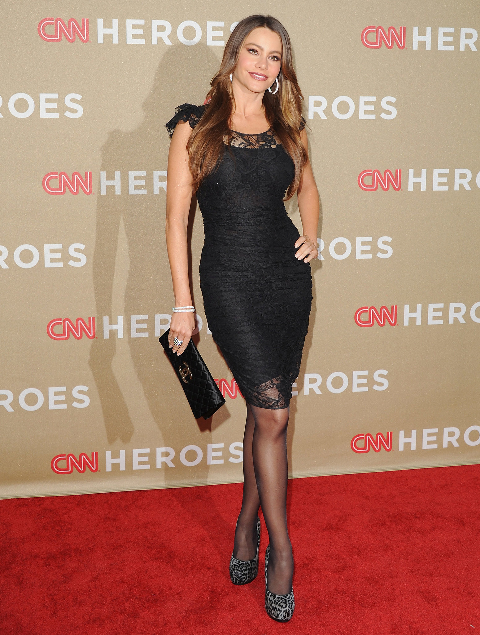 The Columbian beauty showcased major high-fashion growl power in a lacy cap-sleeved LBD, leopard platforms, and a quilted Chanel clutch for a 2011 CNN Heroes event.
