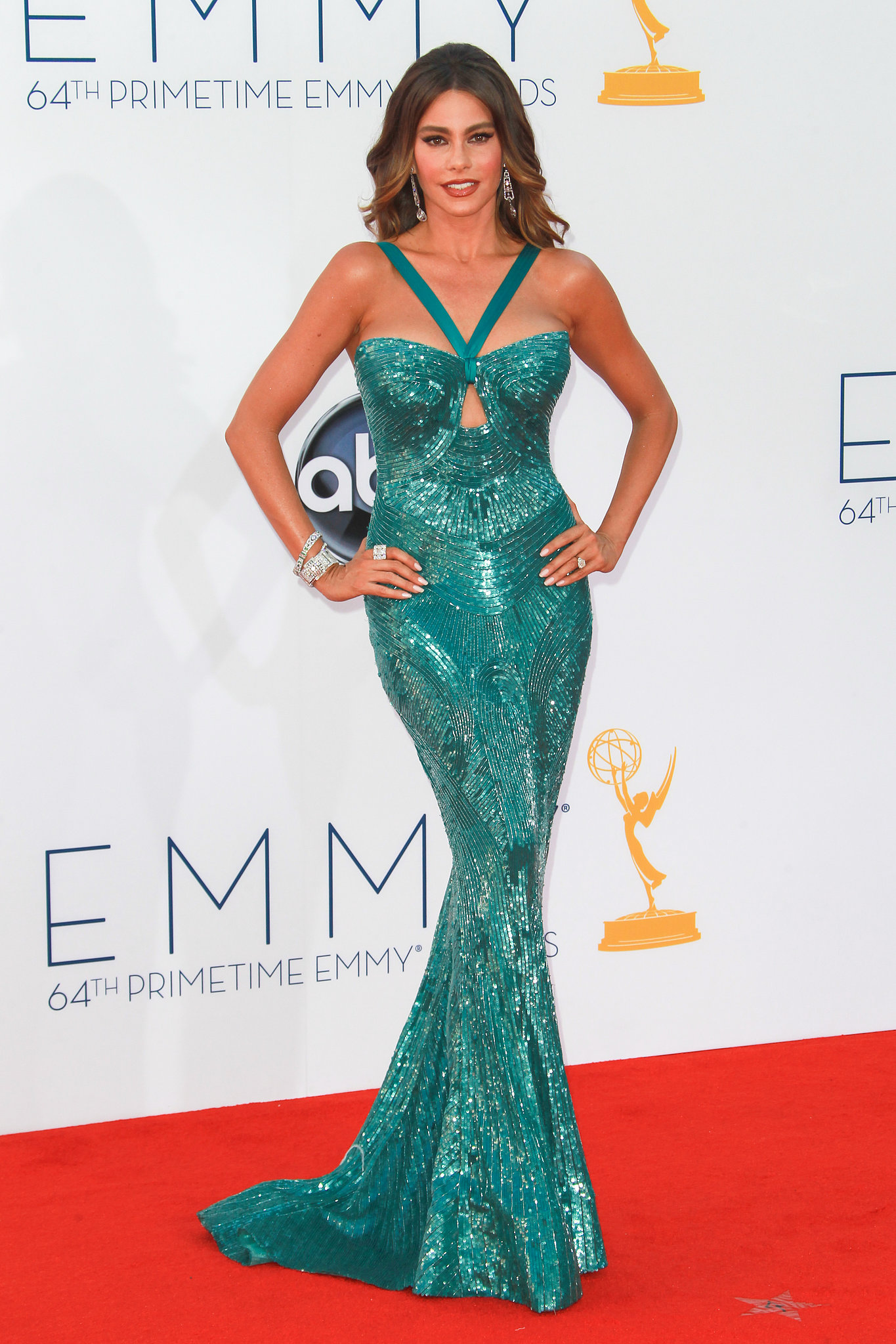 For the 2012 Emmy Awards, the Modern Family star turned up the heat in an allover teal, embellished Zuhair Murad creation. The gown showcas