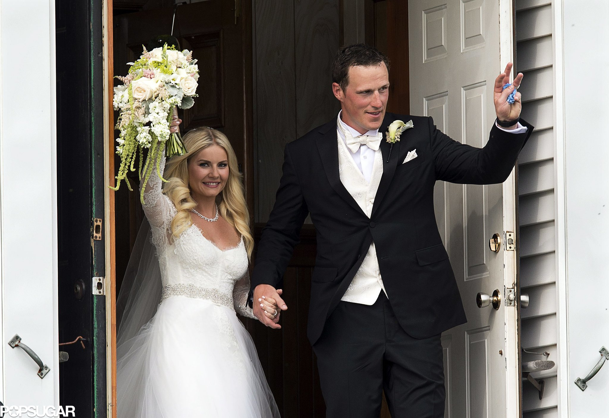Elisha Cuthbert married Toronto Maple Leafs player Dion Phaneuf in Canada in July 2013.