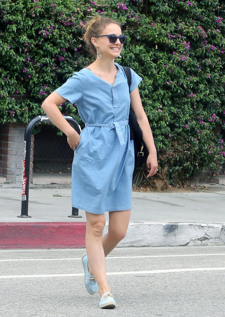 Natalie Portman looked simultaneously relaxed and polished during a day out in LA. Pair your denim dress with Soludos lace-up espadrille flats, colored sunglasses, and chandelier earrings for the same stylish effect.