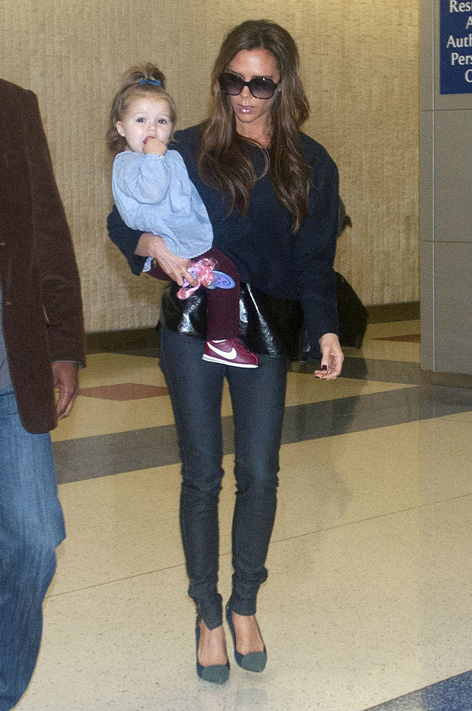 Harper and Victoria made their way through JFK Airport in Oct. 2012.