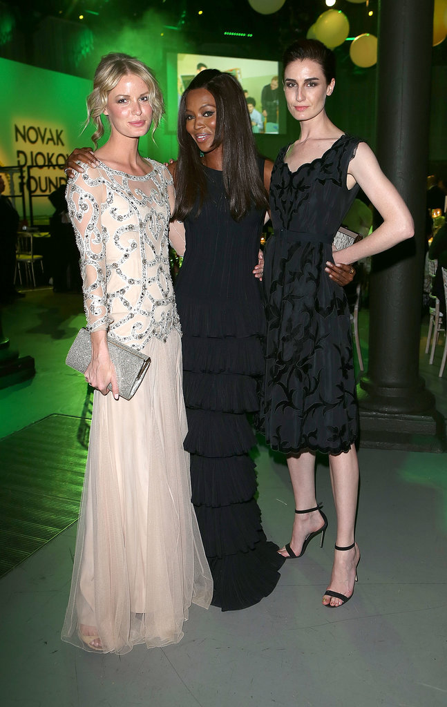 Caroline Winberg, Naomi Campbell, and Erin O'Connor struck a pose at the Novak Djokovic Foundation gala dinner.