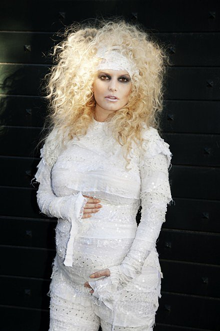 Jessica Simpson confirmed her first pregnancy by sharing a picture of her mummy Halloween costume on Halloween in 2011. Source: JessicaSimpson.com