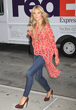 Heidi Klum amped up her skinny denim via a red, sheer printed top and brown suede pumps.