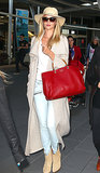 Rosie Huntington-Whiteley demonstrated first-class style in her ankle-length knit duster, which picked up on the color of her boots. And for the ultimate pop of color? A bag in the most gorgeous shade of red.