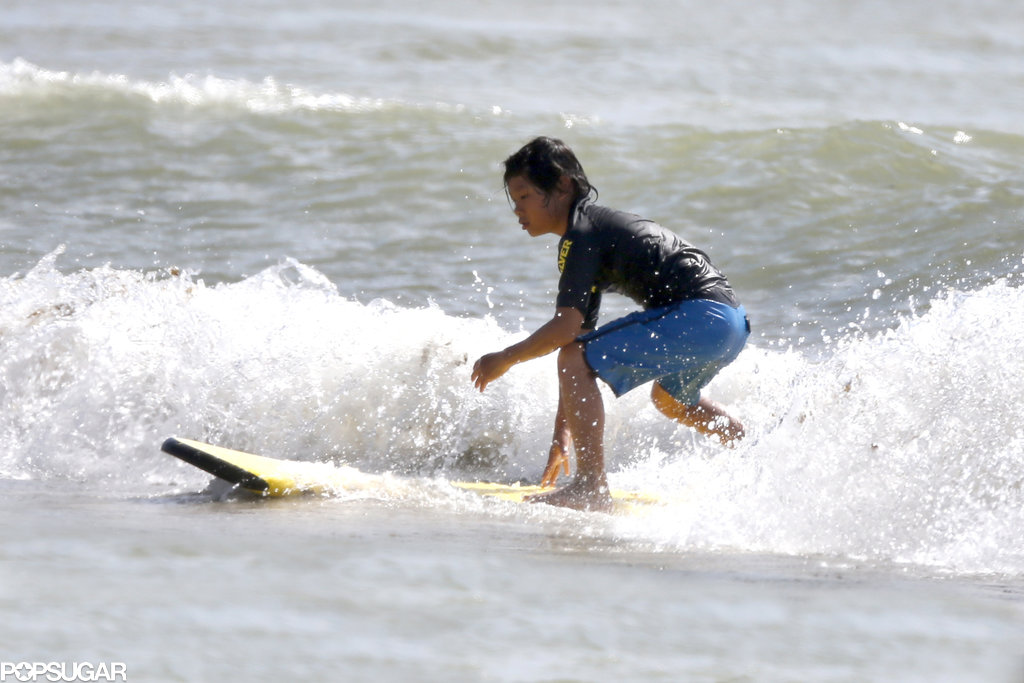 Pax got in some surfing time in Hawaii while Angelina scouted locations for her new film, Unbroken.