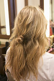 Now your hair should look like this, with a loose knot in the middle of your hair. It might look awkward, but you'll need it for later in the look.
