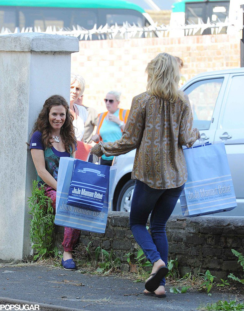 Kate Hudson carried shopping bags on set in London.