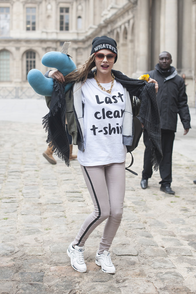 We already knew Cara had a sense of humor when it came to style — this is the official proof. Check out her statement tee and beanie with a message — plus those Chanel sneakers.