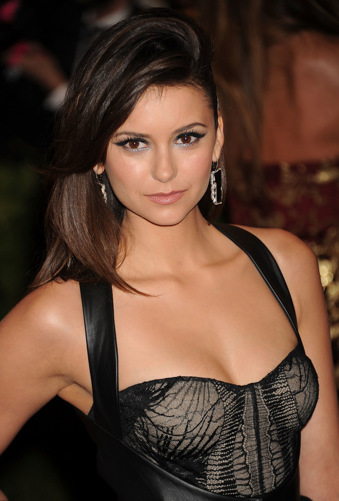 Don't know what to do with your blowout on day two? Try Nina Dobrev's lopsided look.