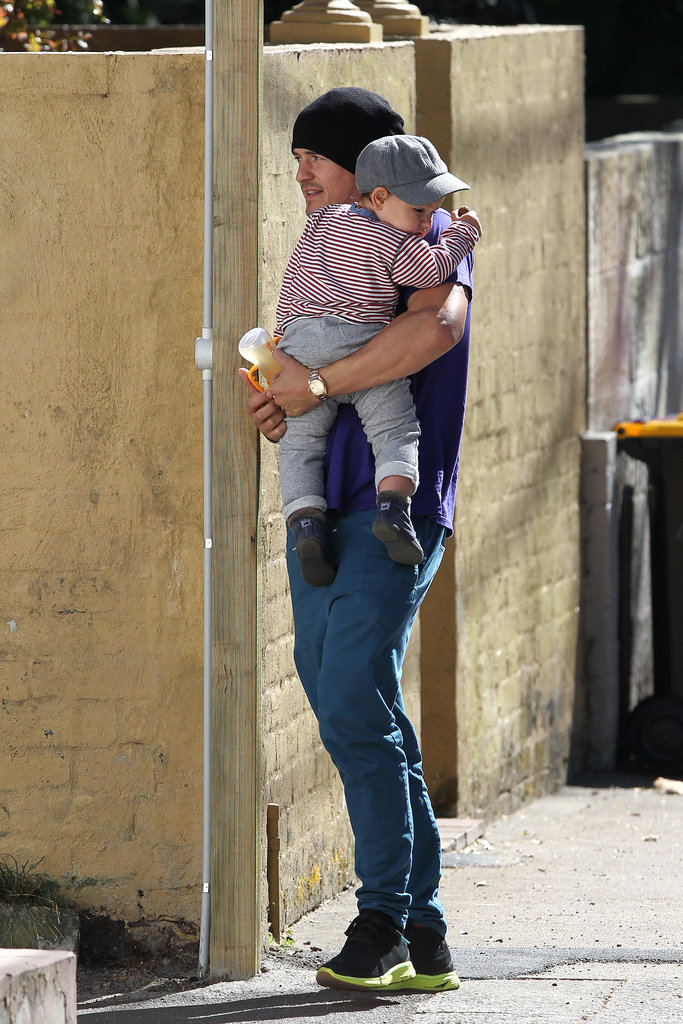Orlando carried Flynn during a walk in Sydney in Aug. 2012.