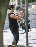 Orlando helped Flynn into a swing in Central Park, NYC, in July 2013.