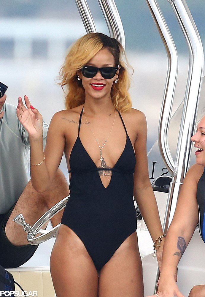 Rihanna's swimsuit revealed her sexy décolletage and a gold body necklace.
