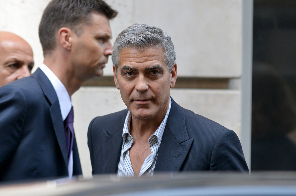 George Clooney wore a blue suit in Paris.