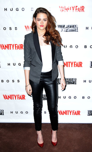 Stewart went for a cool leather look for a screening of On the Road in December 2012. She styled up a pair of slick faux-leather H&M pants, a slouchy white tee, and a BCBG Max Azria blazer with red Christian Louboutin heels.