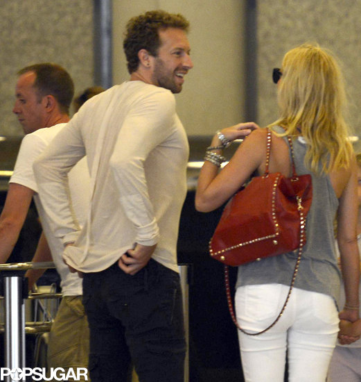 Gwyneth Paltrow and Chris Martin chatted at the airport in Spain.