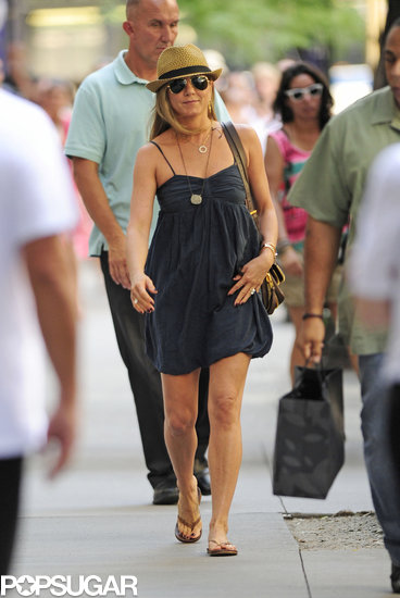 Jennifer Aniston smiled while walking to her set on July 16.