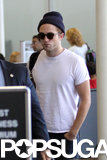 Robert Pattinson made his way through security at LAX before catching a flight to Toronto.