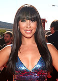 Blunt bangs drew everyone's eyes to Cheryl Burke's dark eye shadow and lengthy lashes.