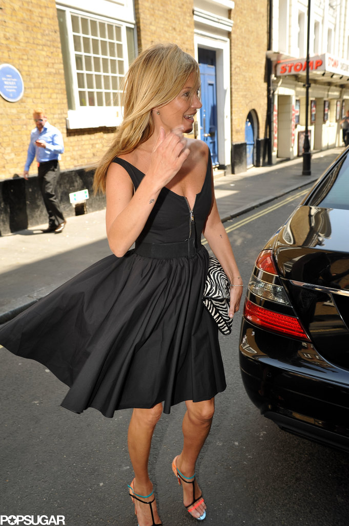 Kate Moss laughed as her dress blew up in the wind.