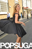 Kate Moss's dress flew up in the wind in London.
