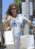 Gisele Bündchen carried shopping bags from a children's clothing store in Brentwood.