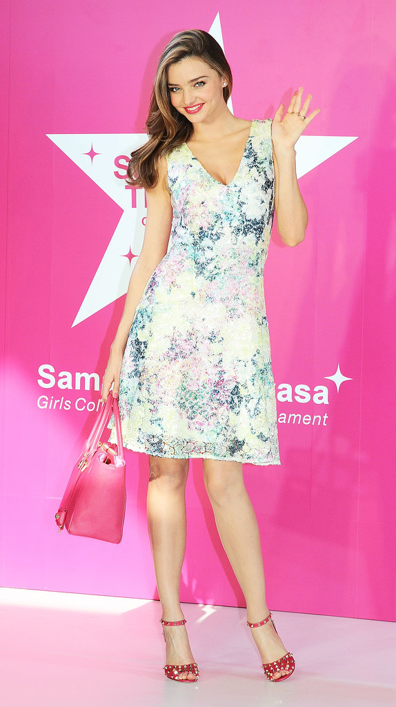 Miranda was undeniably feminine in a floral minidress and a pink purse at the Samantha Thavasa event in Japan.