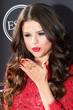 Selena Gomez was the lady in red at the ESPY Awards. She wore ruby lips and nails to match her dress. Hers was our favourite beauty look from the ESPYs red carpet.