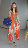 Miranda Kerr never fails to impress, even at the airport. This time, she traveled in style in a floral Wes Gordon maxi with a bright cobalt tote in tow.