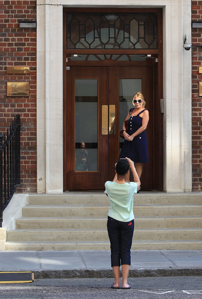 Tourists snapped pictures outside the hospital where Kate's expected to give birth.