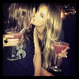 Jennifer Hawkins planted one on her sister, Kristy, while the pair enjoyed a couple of delicious-looking cocktails. Source: Instagram user jenhawkins_
