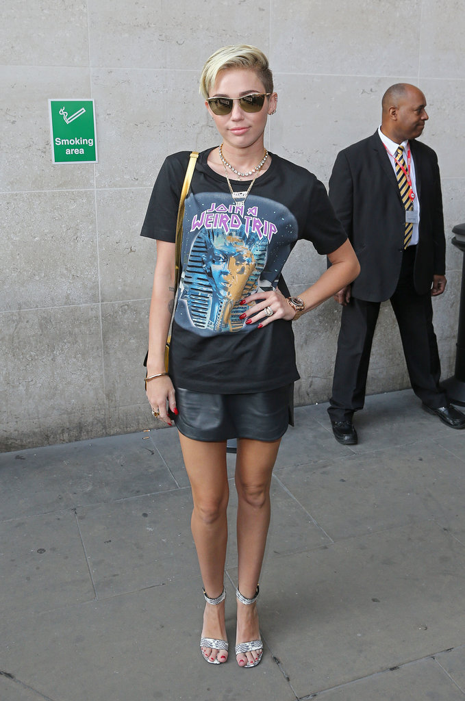 Miley wore a graphic print tee and leather miniskirt when she dropped by the BBC Radio 1 studios in London on July 18.