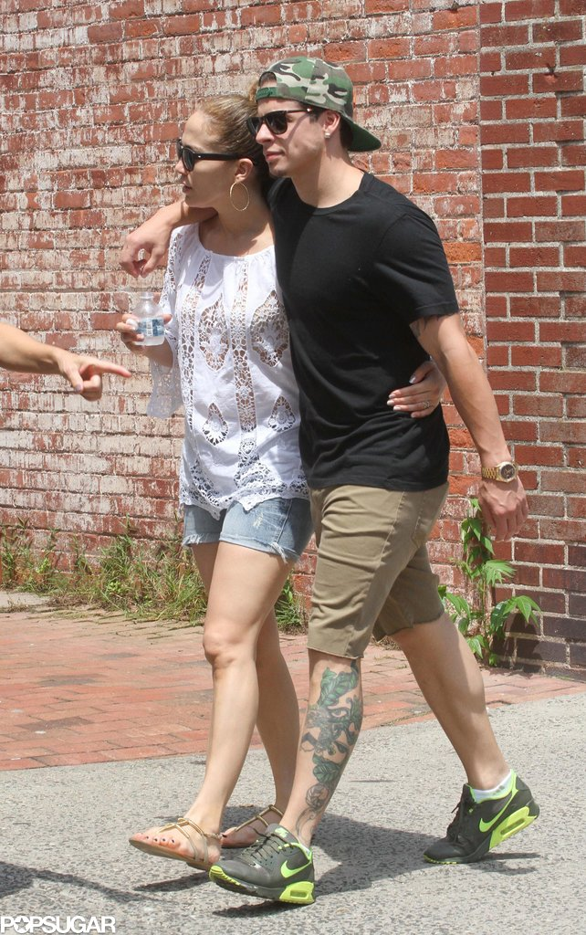 Jennifer Lopez had her arm around Casper Smart for a stroll in the Hamptons.