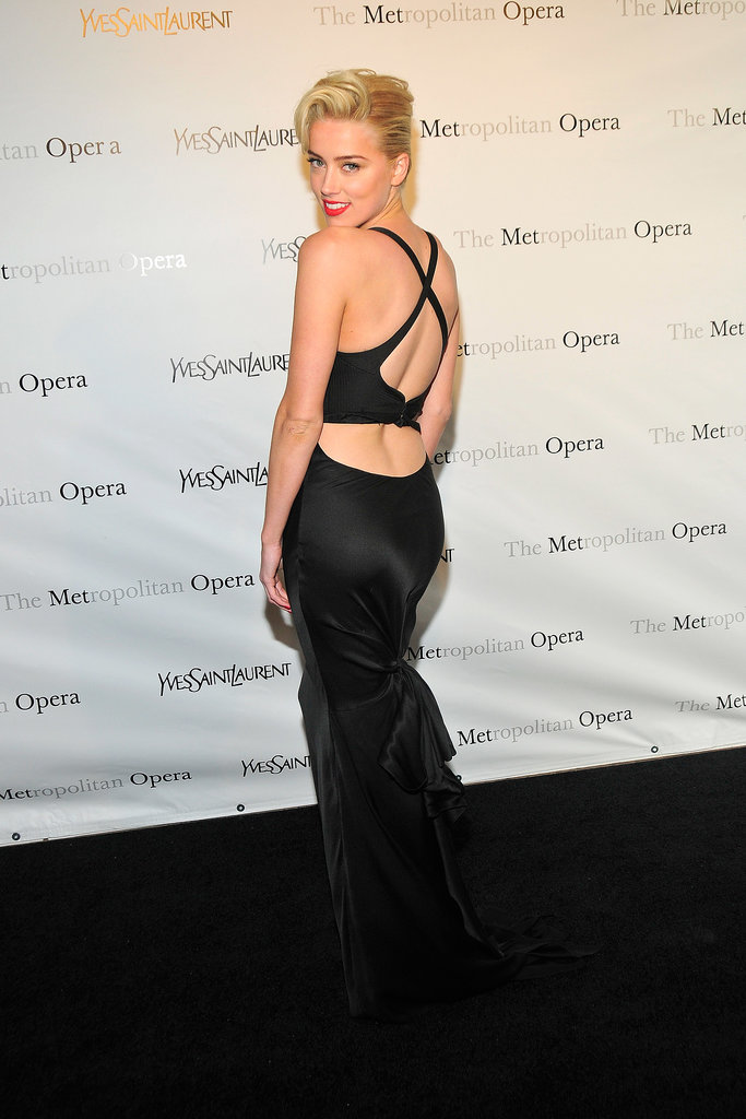 Amber showed off her sexy back in a black satin gown at the Metropolitan Opera gala in March 2012.