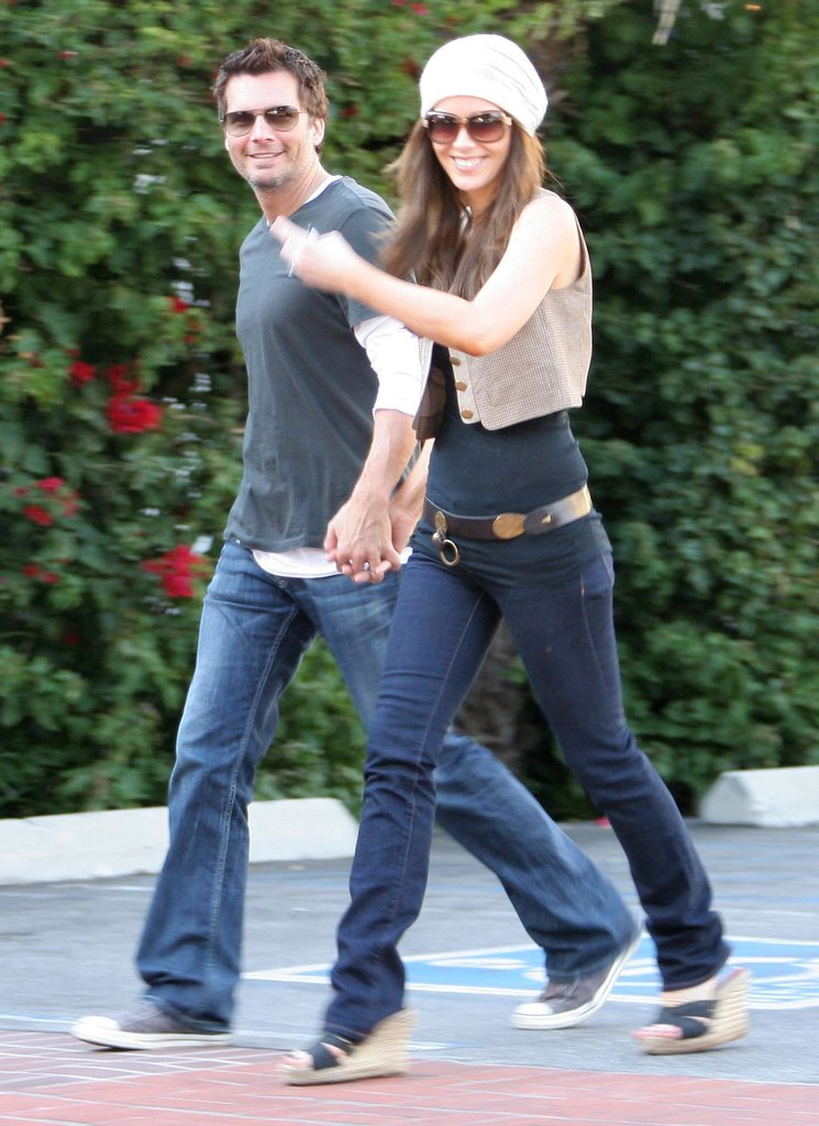 Kate shrugged on a cropped knit vest while smiling for the photographers in April 2008. Even her husband, Len Wiseman was paparazzi-friendly.