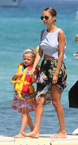 Nicole Richie strolled the South of France in a baby blue crop top, a floral maxi skirt, and Ray-Ban aviators.