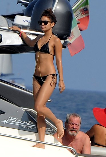 Vanessa Hudgens rocked a black triangle bikini — and a shiny gold body chain — on a yacht in Italy.